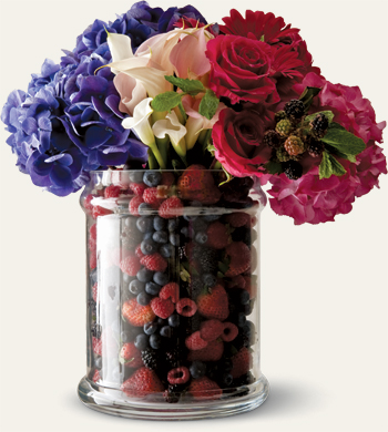 Flowers in vase with berries