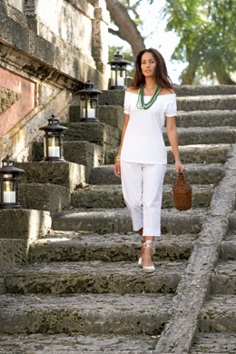 Woman in white on steps